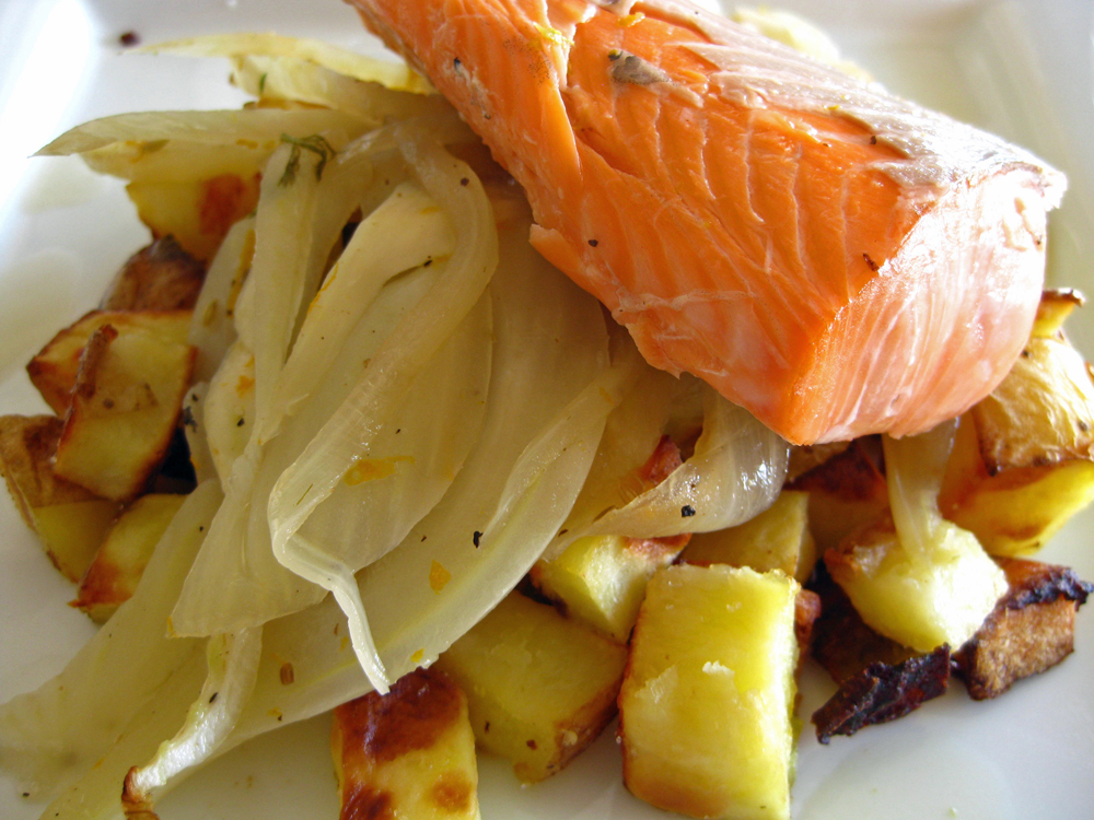 Baked salmon with fennel and orange zest, on top of roasted potatoes.