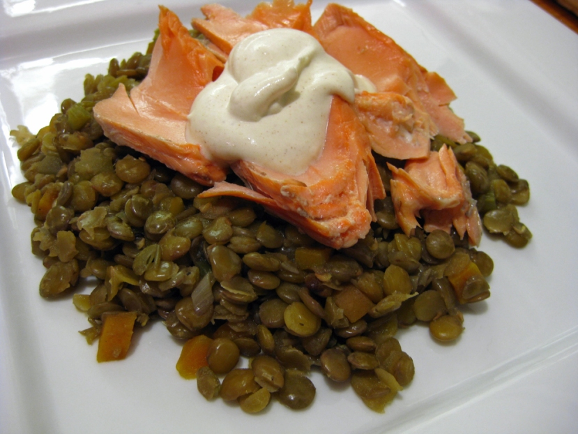 Poached salmon on top of a bed of lentils, with a dollop of dijion creme fraiche.