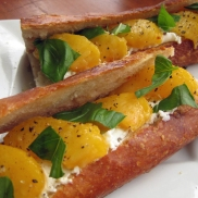 Goat cheese, peach, and basil on a baguette.
