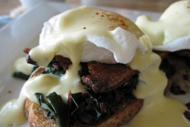 Crisp bacon, sauteed chard, and creamy hollandaise sauce in another Eggs Benny brunch.