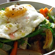 An olive oil fried egg sits atop the delicious le tourin.