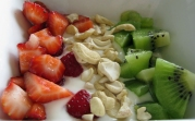 Yogurt with fruit and nuts.
